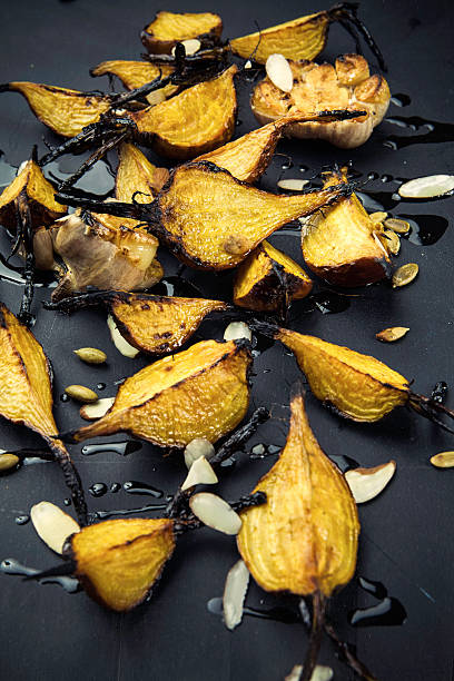 Roasted Golden Beets with Almonds stock photo