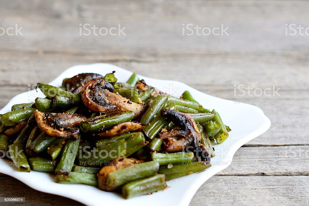 Roasted green beans with mushrooms and spices zbiór zdjęć royalty-free