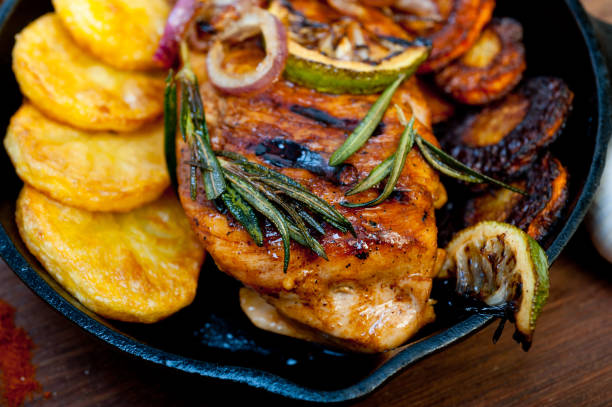roasted grilled BBQ chicken breast with herbs and spices stock photo