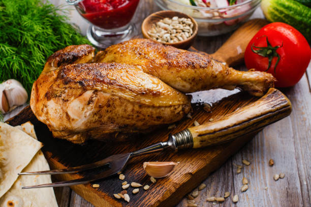 Roasted half chicken stock photo