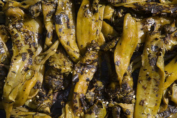 roasted hatch chile peppers - green chilli pepper stock photos and pictures