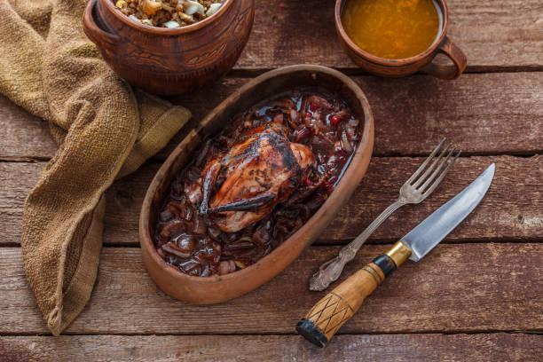 Roasted Hazel Grouse meat with buckweat porridge and cranberry sauce stock photo