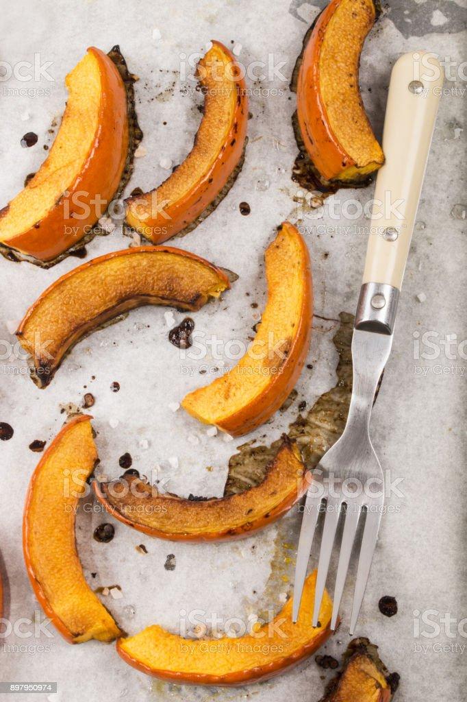 roasted hokkaido pumpkin wedges with salt and black pepper stock photo