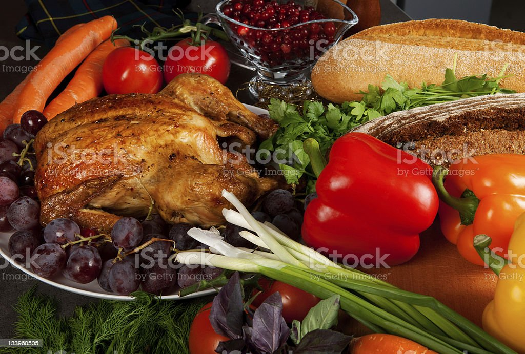 Roasted holiday turkey with fruits and vegetables royalty-free stock photo