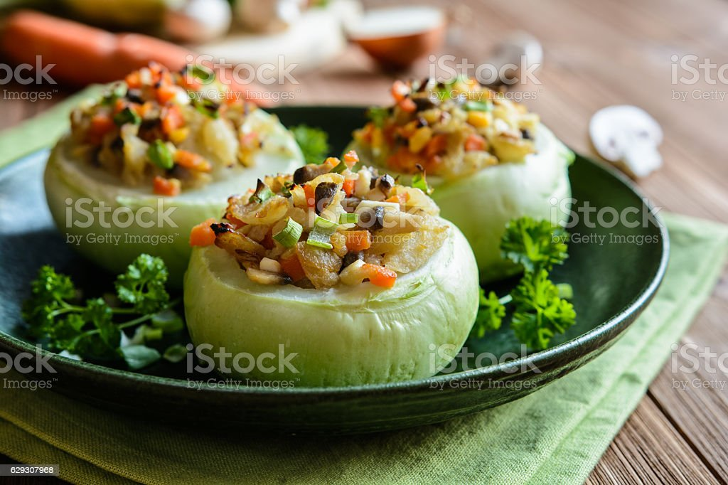 Roasted kohlrabi stuffed with mushrooms, onion and carrot stock photo