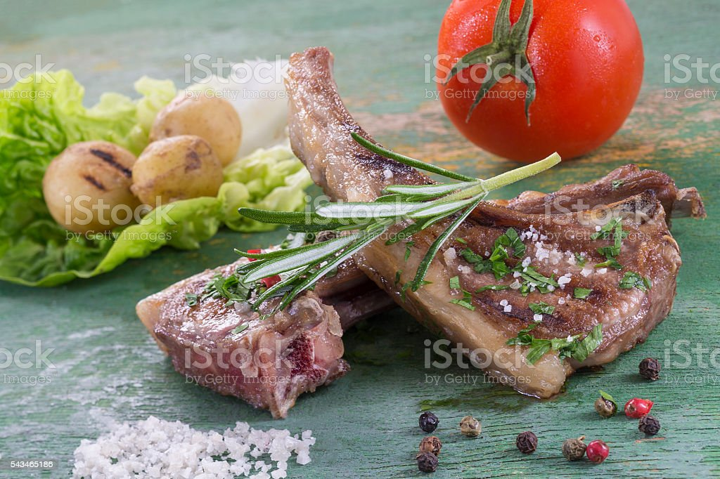 Roasted lamb chops with herbs and pepper stock photo