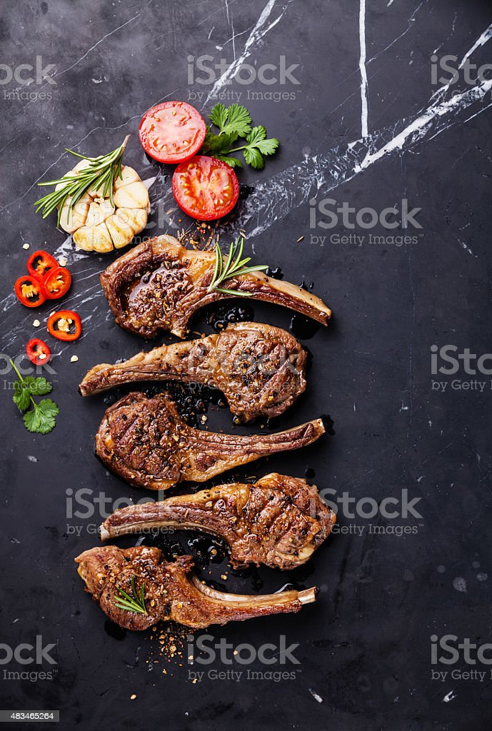 Roasted lamb ribs with spices and garlic stock photo