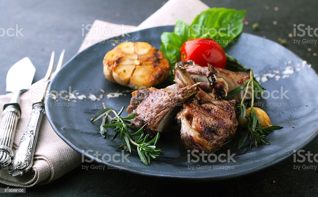 Roasted lamb ribs with spices stock photo