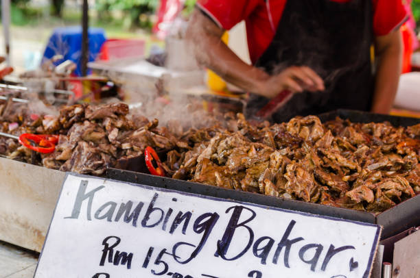 Roasted lamb selling at the Ramadan bazaar, Malaysia. stock photo