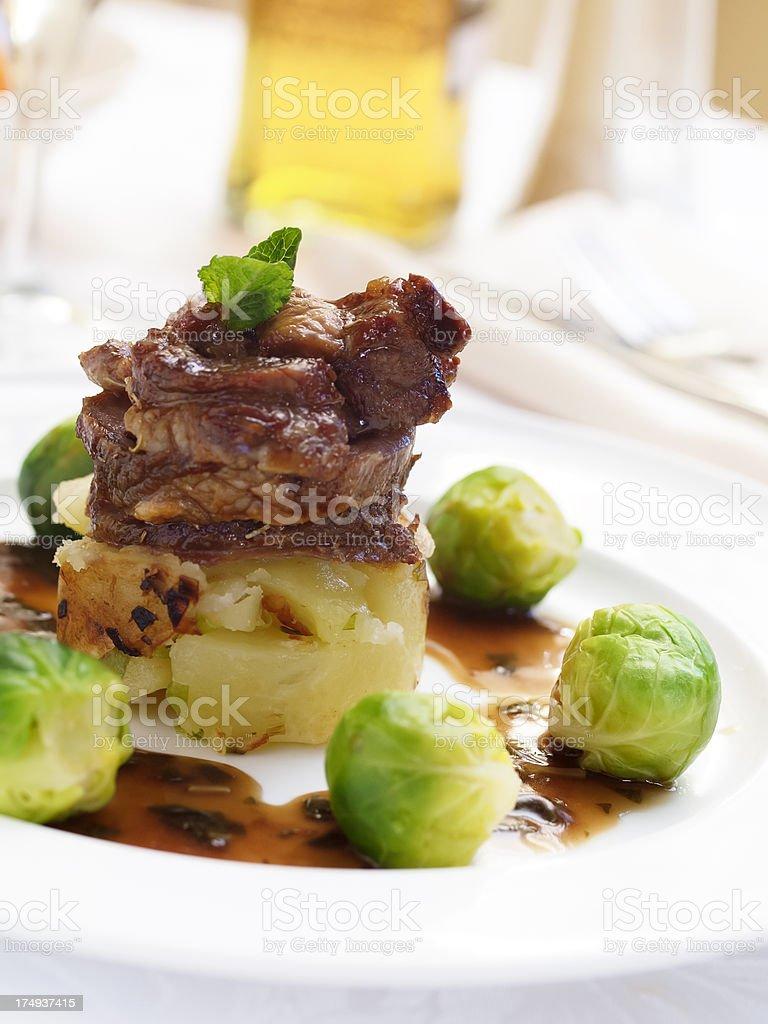 Roasted lamb shoulder royalty-free stock photo