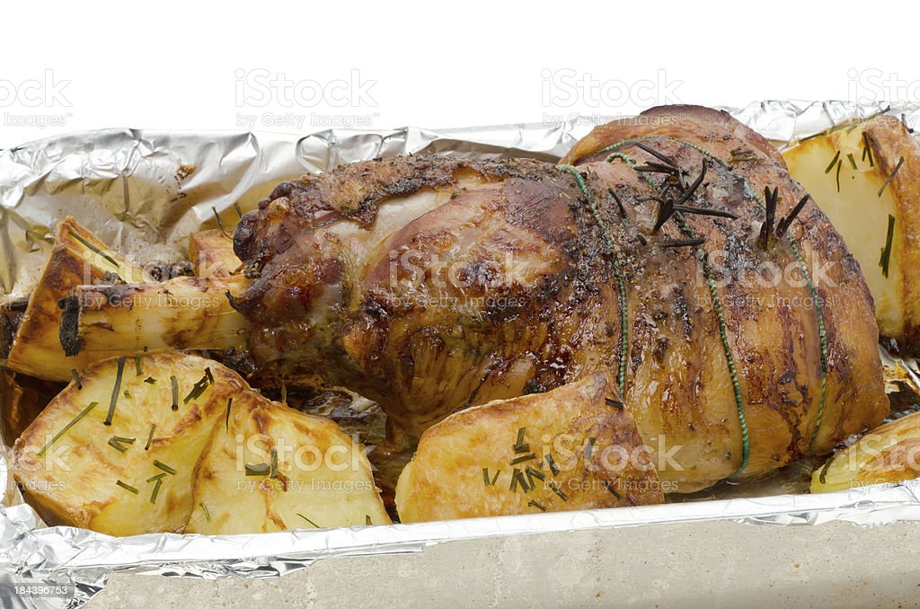 Roasted leg of lamb and roast potatoes royalty-free stock photo