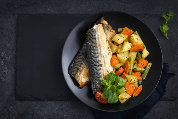 roasted mackerel and vegetables stock photo