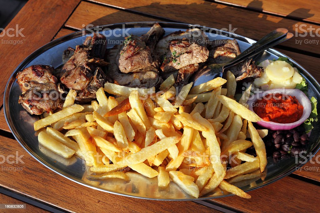 Roasted meat and french fries served in the restaurant royalty-free stock photo
