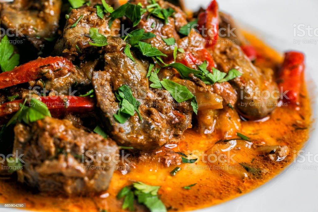 Roasted meat and vegetables. selective focus on the filling close-up. foto stock royalty-free