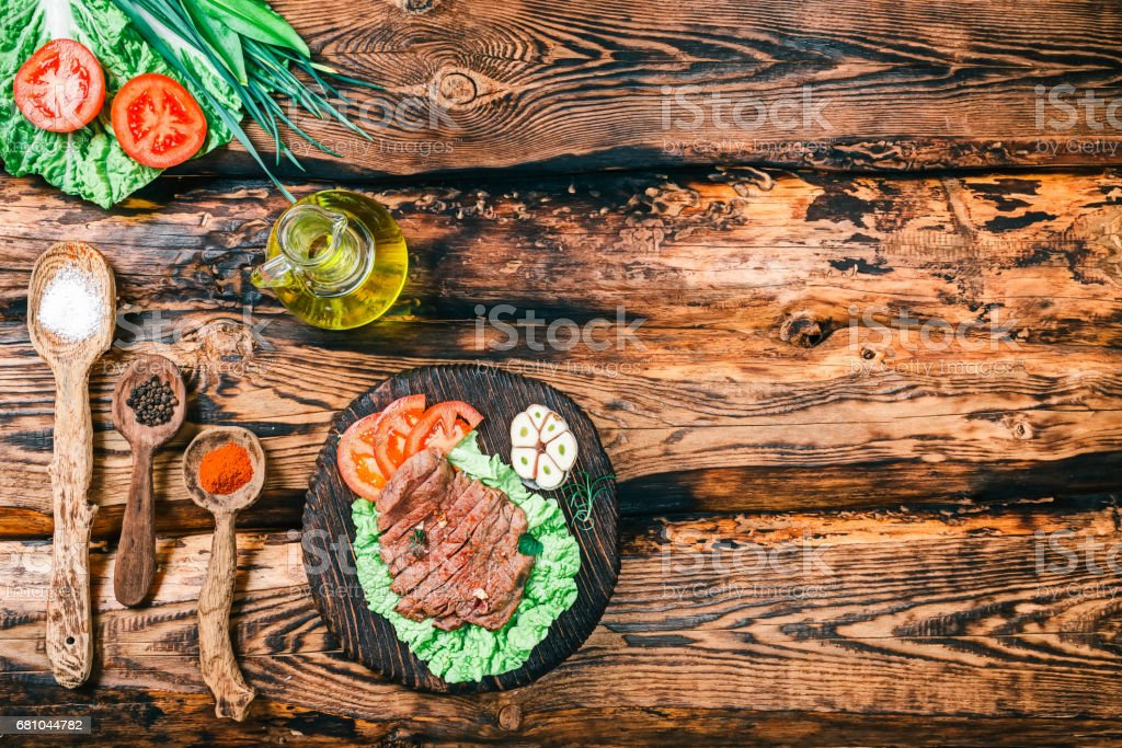 Roasted meat on rustic wood royalty-free stock photo