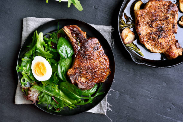 Roasted meat steak with green salad stock photo