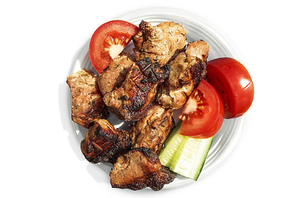 Roasted meat with vegetables on a plate. stock photo