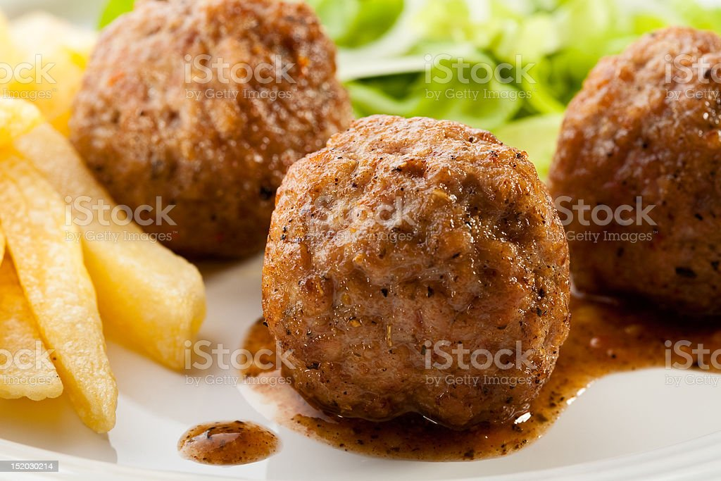 Roasted meatballs and chips royalty-free stock photo
