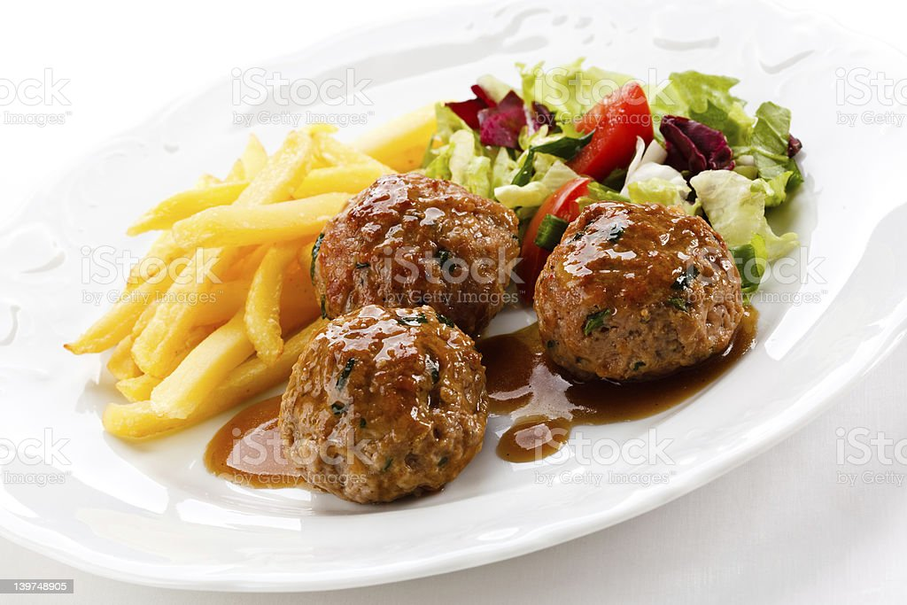 Roasted meatballs and vegetables royalty-free stock photo