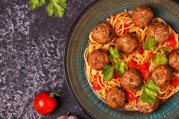 Roasted  meatballs with spaghetti. Roasted  meatballs with spaghetti. Top view, copy space. meatball stock pictures, royalty-free photos & images