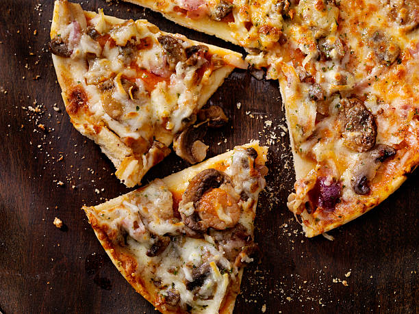 Roasted Mushroom, Garlic and Red Onion Thin Crust Pizza stock photo