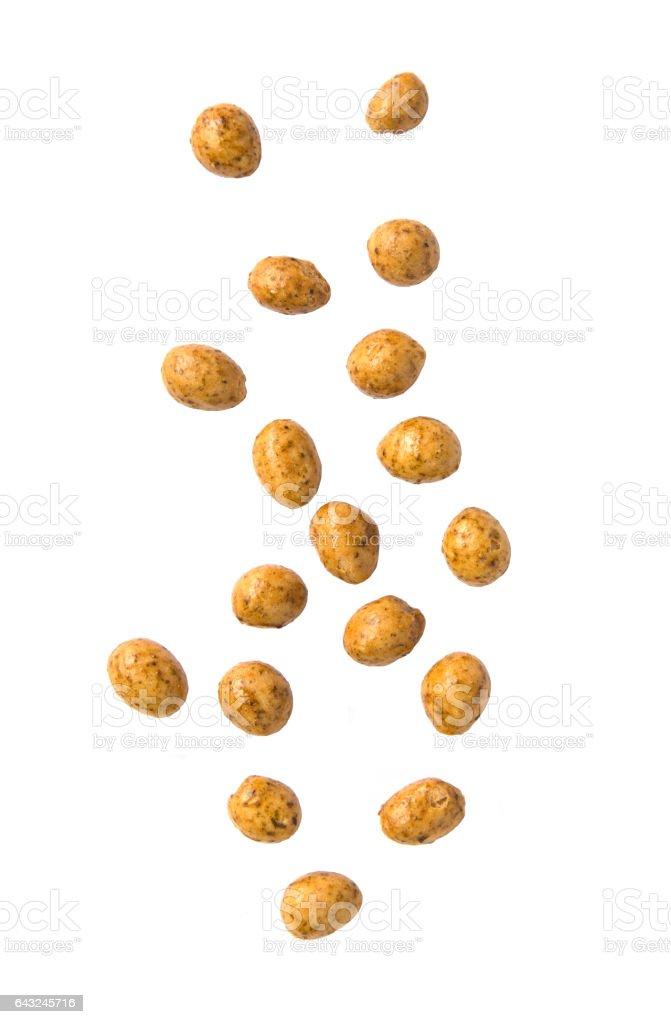 Roasted peanuts coated falling on white background stock photo