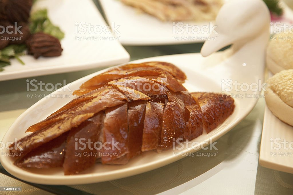 Roasted Peking duck displayed on beautiful white duck plate  stock photo