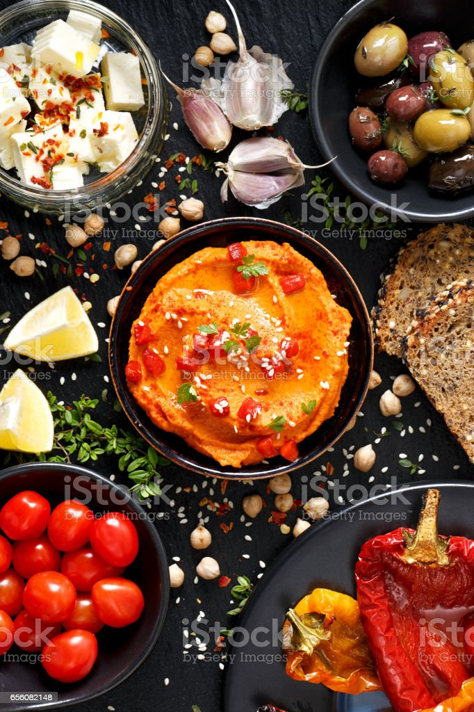 Roasted peppers hummus and and a set of snacks stock photo