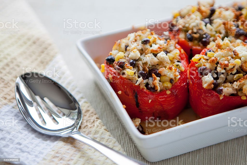 Roasted peppers stuffed with corn, rice and black beans stock photo