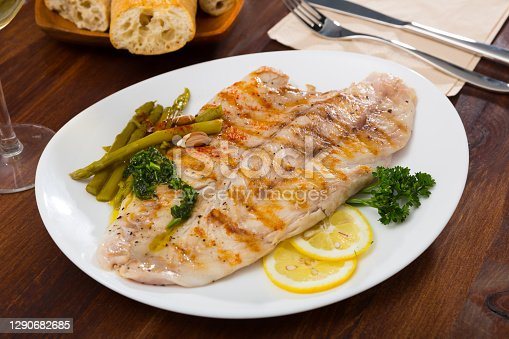 Healthy dinner, oven baked perch fish with vegetables and nuts