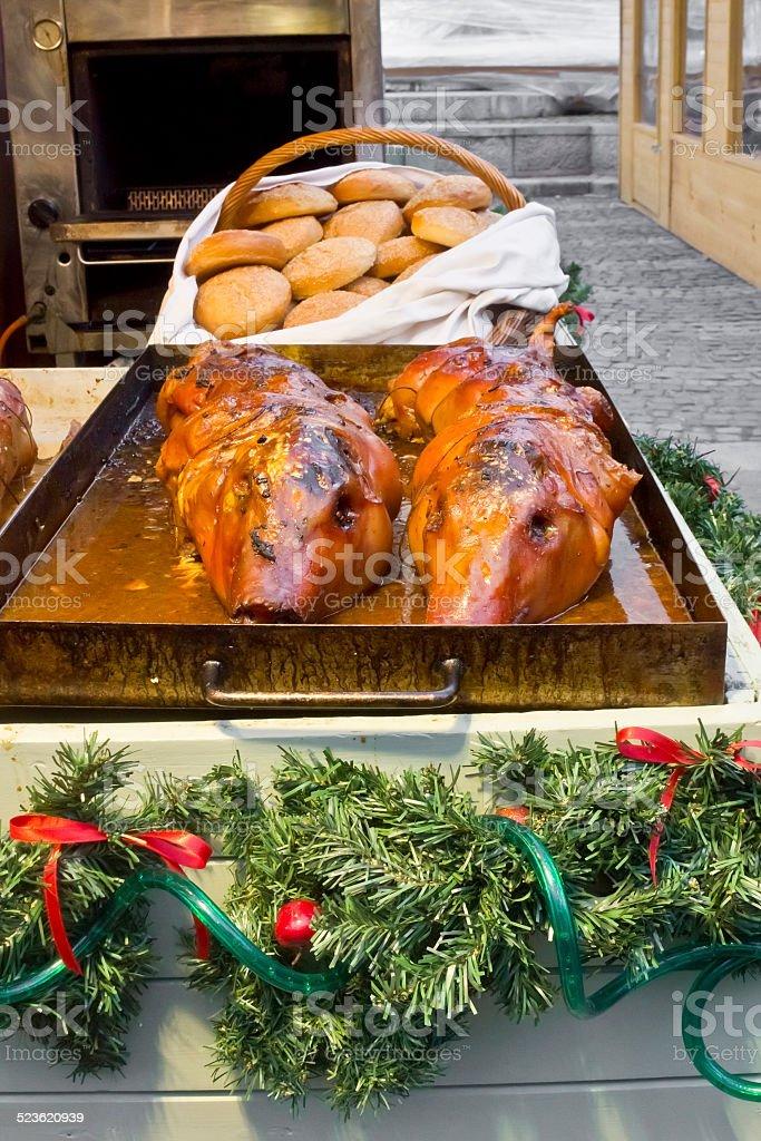 Roasted piggys on christmas fair stock photo
