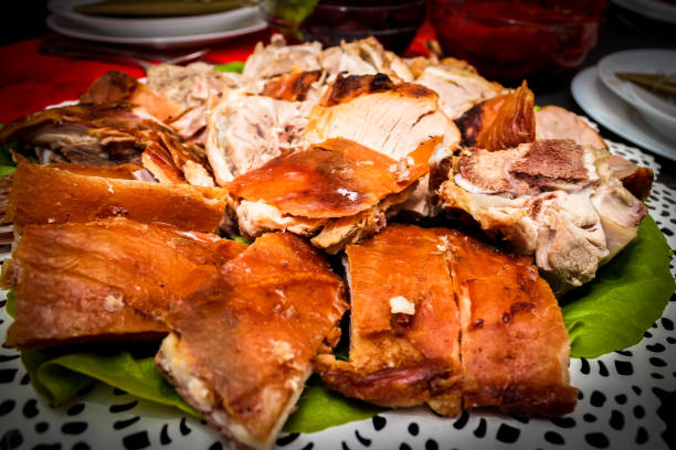 Roasted piglet on a plate Roasted piglet on a plate spit roasted stock pictures, royalty-free photos & images