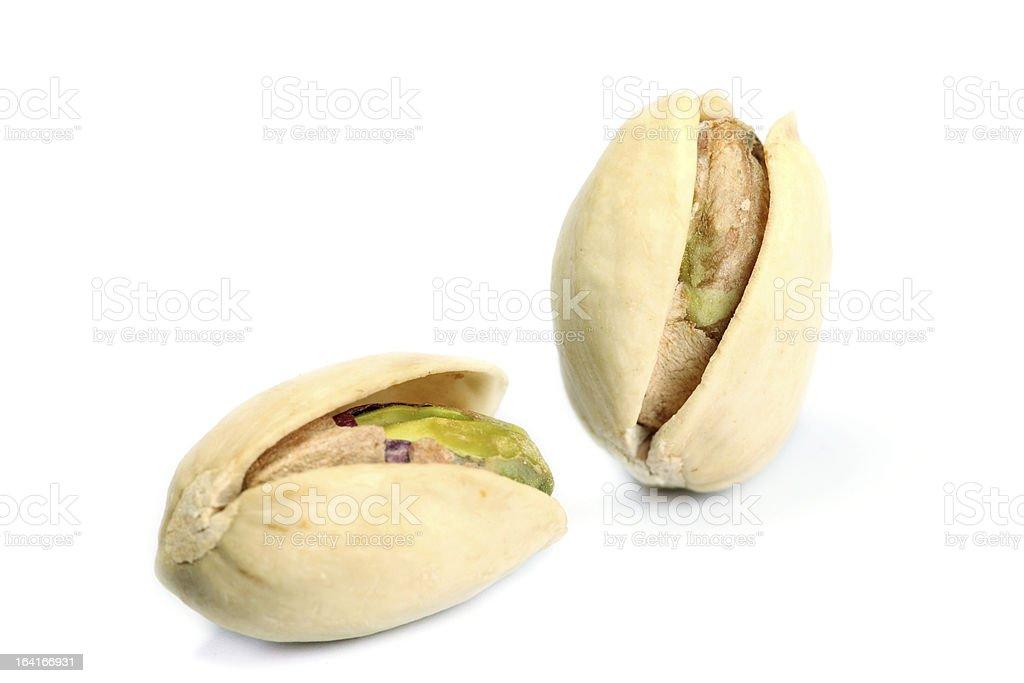 Roasted pistachios on white background royalty-free stock photo