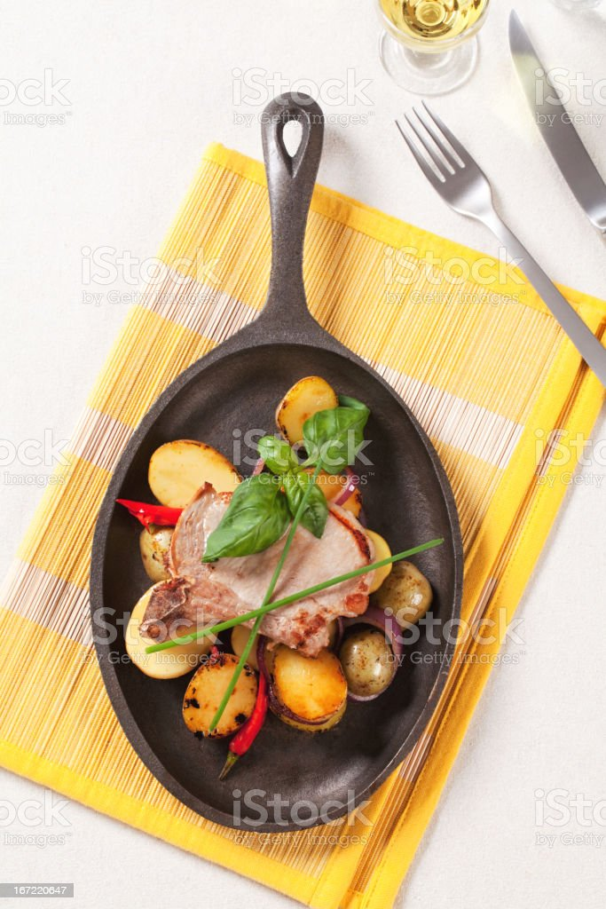 Roasted pork chop and potatoes royalty-free stock photo