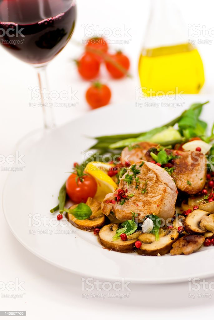 roasted pork fillet - tenderloin with vegetables,red Wine royalty-free stock photo