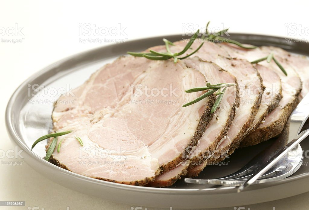 roasted pork neck with black pepper and herbs stock photo