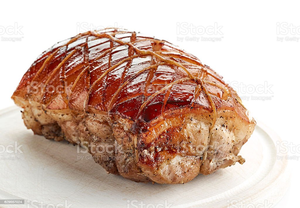 roasted pork on wooden cutting board stock photo