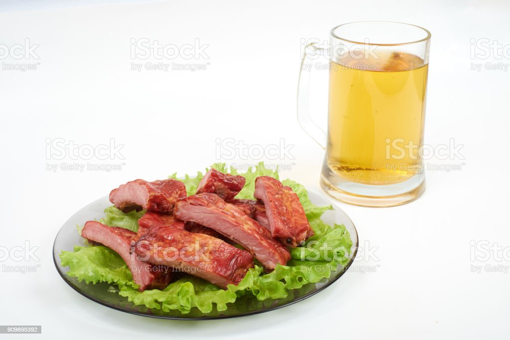 Roasted pork ribs and beer isolated on white background stock photo