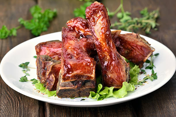 roasted pork ribs - ribs stock photos and pictures