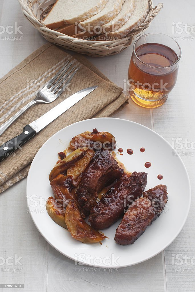 Roasted pork ribs with apple sauce royalty-free stock photo