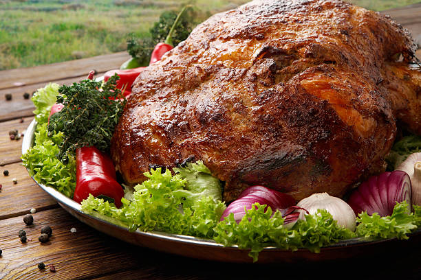 Roasted pork shoulder with vegetables, meat dish Restaurant food, roasted pork shoulder. Meat dish. Festive banquet dish, holiday dish. Catering. Served main dish, roasted pork with vegetables and herbs. Closeup at wooden rustic background. pork stock pictures, royalty-free photos & images