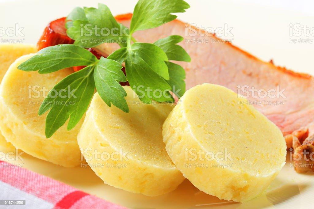 Roasted pork with potato dumplings stock photo