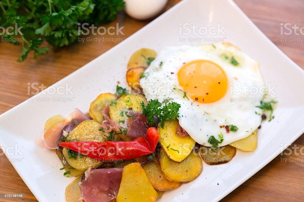 Roasted potato and egg, Huevos rotos stock photo