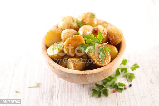 Roasted Potato And Herbs Stock Photo & More Pictures of Baked