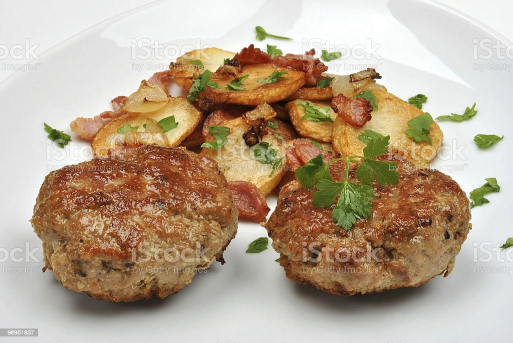 roasted potato with rissole and organic parsley royalty-free stock photo