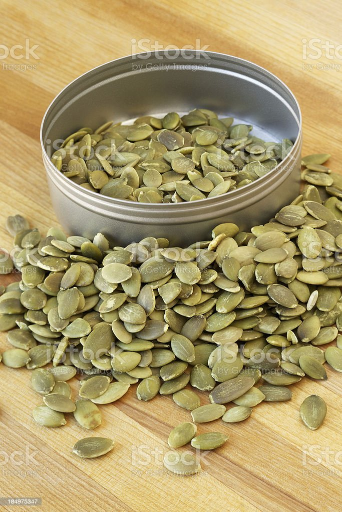 Roasted pumpkin seeds on wood table royalty-free stock photo