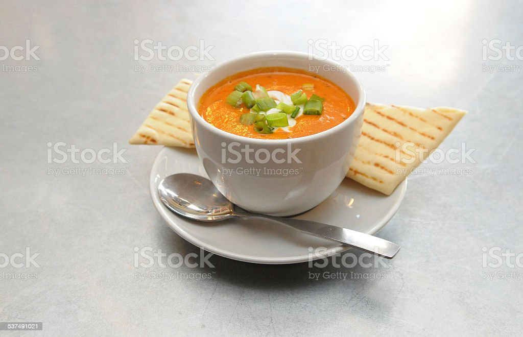 Roasted Red Pepper Gouda Bisque Presented stock photo