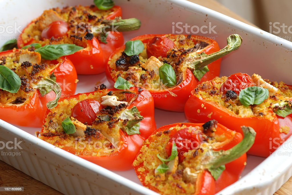 Roasted red peppers filled with couscous stock photo