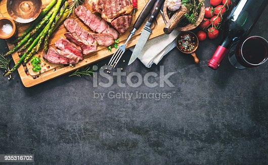 808351132 istock photo Roasted rib eye steak with green asparagus and wine 935316702