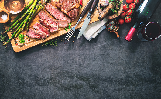 istock Roasted rib eye steak with green asparagus and wine 935316702